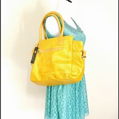 """Faux yellow Python leather hobo Bag by Lionel New with tag Python faux leather Hobo bag by Lionel, this is a close out bag, it has 2 pockets inside, 1 of them with a zipper same thing outside  , plus an outside zipper for closing the bag.    measures approx.:  12."""" Long by 18."""" Wide. After a closer inspection I noticed it has some scratches on a handle Lionel Bags Hobos"""