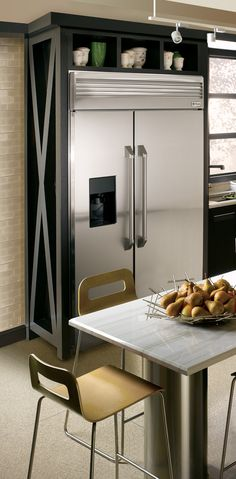 Custom details add drama to small spaces. Brilliant for fridge or any other appliance that sticks out
