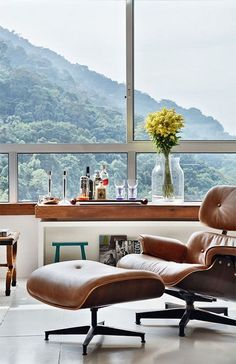 All you need is an Eames lounge, some booze, and an incredible view.