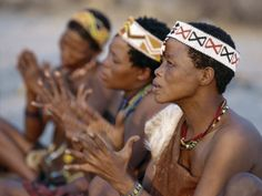 Africa | Kung Women Sing and Clap their Hands, They are San Hunter-Gatherers, Often Referred to as Bushmen | © Nigel Pavitt