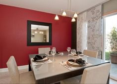 Modern dining room with unique window panels and red wall - Homeclick Community