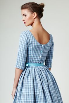 "https://www.cityblis.com/item/10928   ""Karenina"" - linen dress with button up back - $374 by Mrs Pomeranz   Silhouette: fitted bodice with boat neck at the front and low back, three quarter sleeves and full, gently pleated midi skirt. The belt is made of mint green silk, the top and skirt are lined. The dress closes side with invisible zip and back with 5 big buttons covered with silk.  Size/Dimensions/..."