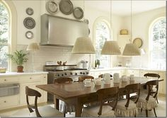 Beautiful kitchen designed by Lanham. It is light and fresh, traditional but not at all stuffy. Note the painted floor. Also interesting to note that the range seems to be standalone – the counters do not go to the edge. said by Things That Inspire blog.