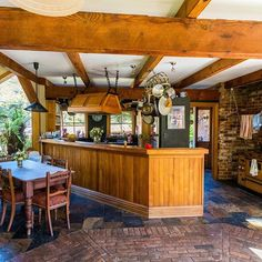 Kitchen and breakfast table , beautiful recycled oregon beams , kauri and rimu counter, recycled bricks and slate. Recycled Brick, Bricks, Slate, Homesteading, Beams, Liquor Cabinet, Counter, Oregon, Lifestyle
