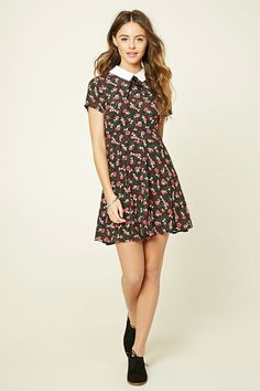 A woven dress featuring an allover floral print, self-tie accent, contrast collar, back keyhole cutout, and a skater silhouette.