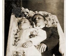 The death of a child must be heart-breaking, but the loss of more than one must be almost unbearable.  The parents decided to have both children photographed together - almost as if they are snuggled together in sleep.