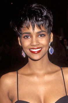 Berry's hair evolution is all the inspiration you need because contrary to popular belief, having short hair shouldn't limit your styling options. Halle Berry Haircut, Halle Berry Pixie, Halle Berry Hairstyles, Halle Berry Hot, Pixie Hairstyles, Haircuts, Pixie Haircut Styles, Curly Hair Styles, Halle Berry Bikini