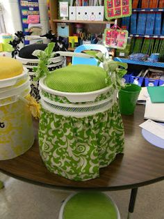 Bucket Stools....how cute!  They can be made to match your classroom theme/decor.  Bucket seats aren't a new idea, but these are some of the cutest ones I've seen. Super cute!!!