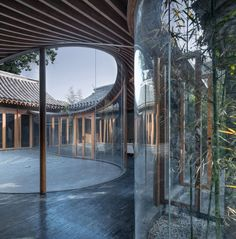 Arch Studio have reconnected the spaces of Qishe Courtyard, a once-abandoned hutong in Beijing with curving glass walls and courtyards. Asian House, Bamboo Panels, Glazed Walls, Glass Brick, Internal Courtyard, Studios Architecture, Brick And Wood, Curved Walls, Old Bricks