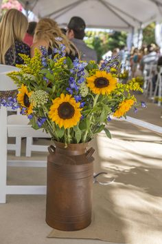 Large Ceremony Floral Arrangements with Sunflowers in milk can Venue: Jackson Rancheria Casino Resort Flowers: Wildflowers at Jackson Rancheria Rustic Burlap and Lace Country Wedding Navy Blue and Sunflowers Sunflower Arrangements, Fall Floral Arrangements, Beautiful Flower Arrangements, Wedding Flower Arrangements, Sunflower Bouquets, Table Arrangements, Navy Wedding Flowers, Floral Wedding, Wedding Bouquets