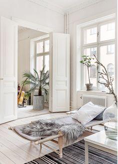 Cot,fur, branches, floorboards, neutrals