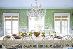 DINING ROOM To balance the formality of the de Gournay wallpaper in the dining room, Turner chose the Cracked Ice rattan chair from McGuire and a plaster chandelier from Harbinger.
