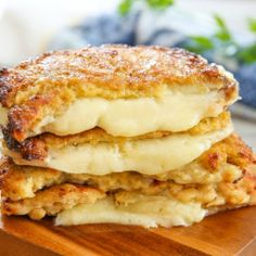 "Make your ""bread"" out of cauliflower! This tasty version of a grilled cheese is gluten-free and lower in carbs. Just look at all of that melty cheese action. - Cauliflower Crusted Grilled Cheese Sandwiches"