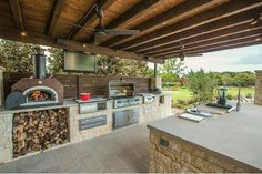 Patio - pizza oven, BBQ, island, sink, warming drawer, fridge.