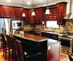 I am thinking about this layout for my future dream kitchen re-do.  lol  The layout only, not the color of the cabinetry.  I'm not into dark woods.  I think it would work in my small kitchen and has all the features I want.
