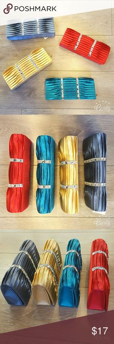 NEW YEARS Evening Bags Clutch Beautiful evening bags with rhinestone garnish.  Satin textured Magnet snap closure  Measurements  4 colors to choose from red, teal, grey, gold Great for going out for a night on the town or to special event! ***PLEASE CONTACT FOR THE COLOR YOU ARE INTERESTED IN WHEN PURCHASED*** Bags Clutches & Wristlets