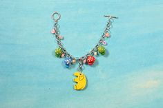 Charm chain bracelet for kids, try to make it with following the tutorial from LC.Pandahall.com