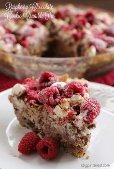 This easy, dreamy, delicious pie includes a chocolate chip cookie crust, chocolate and vanilla ice cream, crumbled cookies, chopped sugar cones, and a fresh homemade raspberry sauce! #holidayrecipes #pierecipes #pie #dessertrecipes #holidaydesserts