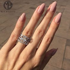 "If you're unfamiliar with nail trends and you hear the words ""coffin nails,"" what comes to mind? It's not nails with coffins drawn on them. It's long nails with a square tip, and the look has. Stiletto Nail Art, Nude Nails, Matte Nails, Coffin Nails, Bridal Nails, Wedding Nails, Wedding Rings, Rose Wedding, Wedding Band"