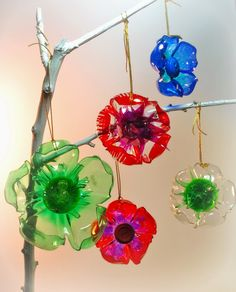 recycled plastic ornaments. Cut off bottom of plastic bottle, color with Sharpies, melt edge over flame.