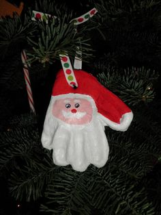 STEP BY STEP GUIDE: A Santa ornament made from a childs hand-print, made from a salt dough clay recipe.