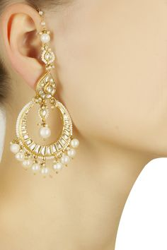 Gold finish kundan and pearl crescent earrings available only at Pernia's Pop-Up Shop