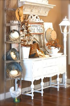 Fall decorating inspiration - pumpkin in a bucket in a ladder, buffet with photos and orange twinkle lights, etc.