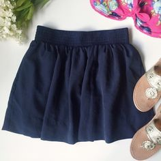 """Navy Blue Skater Skirt 2 pockets • 100% polyester & is lined • elastic waist • gold tone zipper closure on back • when laying flat, length is approx 15"""" • shown in Covershot with NWT Hollister Floral Bandeau, see separate listing for more details Forever 21 Skirts Circle & Skater"""