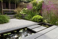 Private garden by John Davies, showcasing our flamed black basalt paving, silver grey granite aggregate and our gravel stabilisation system, cedagravel.