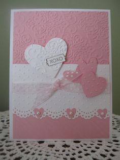 """By Jaimie and Karen Conroy. Die-cut hearts. Dry embossing folders: Sizzix/Stampin' Up """"Vintage Wallpaper,"""" Cuttlebug """"Candy Cane Stripes,"""" and Cuttlebug """"Swiss Dots."""" I don't know the name of the border punch used."""