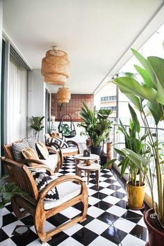 Gorgeous patio with checkered floor, ikea ceiling lights, and comfy wicker chairs