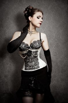 Boudoir chic meets goth glam in this alluring image. #goth #gothic #lingerie #fashion