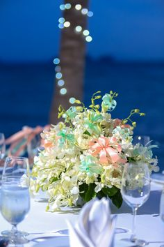 Simple white orchids with hints of soft coral and aqua. Soft Corals, White Orchids, Beautiful Islands, Unique Weddings, Florals, Aqua, Table Decorations, Simple, Inspiration