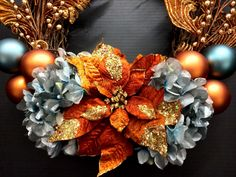 (Detail) Faux Holiday 2014 Season Grapevine wreath: blood orange wire glitter poinsettia, powder blue jeweled hydrangeas, orange and powder blue ornament balls, gold berry picks and baroque copper decorative picks. Original design and arrangement by http://nfmdesign.synthasite.com/
