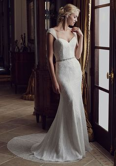 Poppy's detachable beaded belt and detachable fabric sleeves are perfect for the bride who wants to change her look throughout her wedding day. Subtle beading cascades down the length of the gown to the train, where soft satin lining peeks out from beneath the sheer overlay.