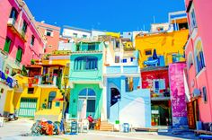 PROCIDA, ITALY, JULY italian island procida is famous for its colorful marina, tiny streets and many beaches which attract every year crowds of tourists coming from naples - napoli. Travel Around The World, Around The Worlds, Costa, Puzzle Of The Day, Beau Site, Colourful Buildings, Italy Tours, Voyage Europe, Decks