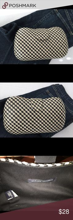 Banana Republic Clutch Bag. Cute clutch with a straw look in black and cream. It is lined and measures 5x8. Has a magnetic snap closure. Only used once. Banana Republic Bags Clutches & Wristlets