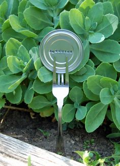 garden markers from can lids - never thought to metal stamp them...nice.