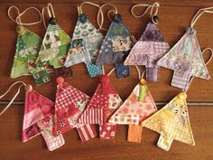 Made for the Small Fox Ornament Swap using little bits of vintage and/or thrifted fabric and vintage buttons. Inspiration came from Kathi Mack's (pink chalk studio) patchwork tree potholder in Quilting Arts Gifts 2009.