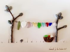 The photos below are of the art work I have created using rocks, twigs, glass, ceramics, and string from the beaches of Nome, Alaska. Inspi...