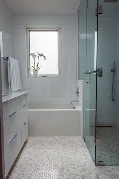 The New Bathroom: 5 Top Trends from Apartment Therapy. Long narrown shower and small bath. Wonder if our bathroom is big enough? Bathroom Tile Designs, Bathroom Floor Tiles, Bathroom Renos, Bathroom Layout, Small Bathroom, Tile Floor, Bathroom Ideas, White Bathroom, Long Narrow Bathroom
