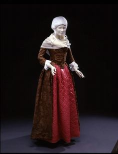c.1780 brown silk dress with a wool quilted petticoat.