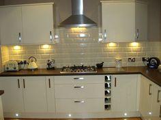 Euro Gloss Kitchen Featuring Under Cabinet Lighting