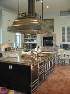 The kitchen's La Cornue double-sided stove is a major draw for serious home cooks. - Courtesy of Hill Riddle, Jr.