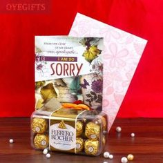 Sorry Greeting Card along with 16 pcs of Ferrero Rocher Chocolate. Ferrero Rocher Chocolates, Dairy Milk Chocolate, Red Paper, Online Gifts, Red Roses, Anniversary Gifts, Birthday Gifts, Unique Gifts, Greeting Cards