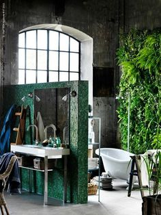 Industrial Loft with a living plant wall in the bathroom.