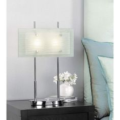 The impressive design of this modern lamp will leave you and your houseguests pleased. This lamp features panes of frosted slumped glass. The unique design and style will be a welcome complement to your modern decor. Two halogen bulbs come included. Office Lamp, Slumped Glass, Glass Desk, Lighting Solutions, Glass Panels, Desk Lamp, Modern Decor, Bulb, Contemporary
