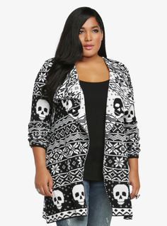 A black and white design with skulls and snowflakes lends a festive but edgy vibe to this extra long open-front cardigan.