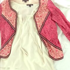 3/4 sleeve small American eagle cover up This pink flower pattern cover up is great for layering and gives an hour glass figure. Tops