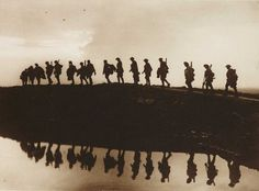 File: Supports going up after battle to relieve the front trenches, note the three observation balloons above the bright cloud Collection of National Media Museum (Frank Hurley/Australian War Records Section) World War One, First World, Hurley, Battle Of Passchendaele, Man Of Honour, Flanders Field, Anzac Day, World History, First Photo